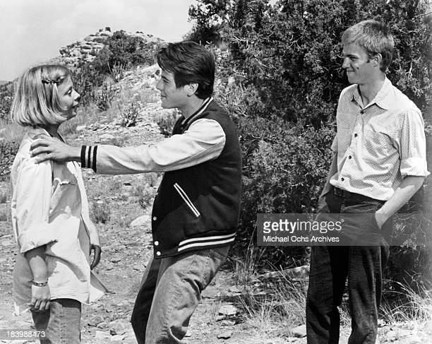 Actor Richard Thomas actress Catherine Burns and actor Desi Arnaz Jron the set of the Universal Pictures movie 'Red Sky at Morning' in 1971