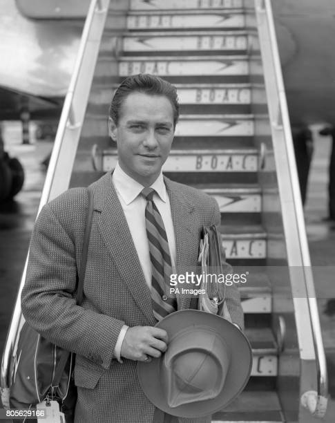 Actor Richard Todd is pictured at London Airport today as he was about to board a BOAC liner for Entebbe Uganda