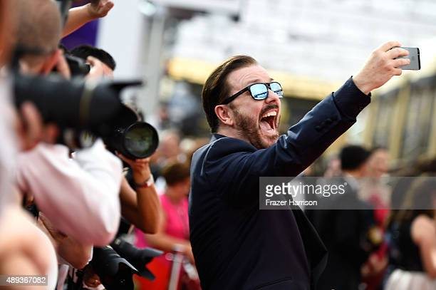 Actor Ricky Gervais takes a selfie at the 67th Annual Primetime Emmy Awards at Microsoft Theater on September 20 2015 in Los Angeles California