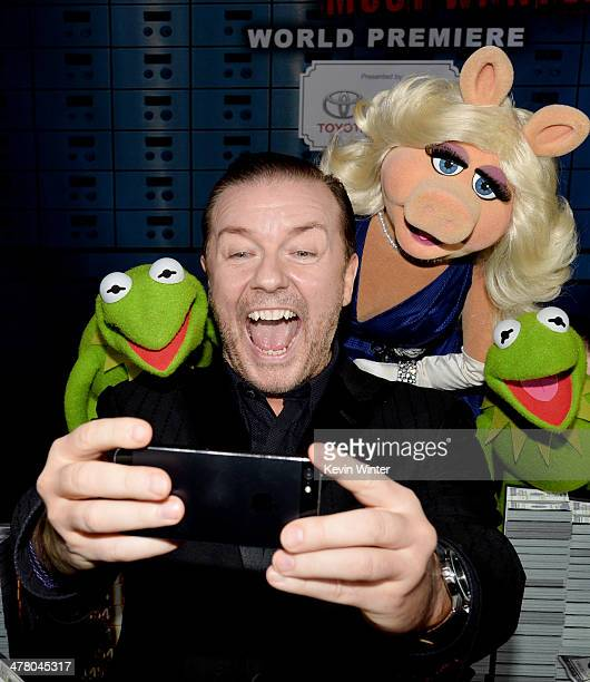 Actor Ricky Gervais with Constantine Miss Piggy and Kermit the Frog pose at the premiere of Disney's 'Muppets Most Wanted' at the El Capitan Theatre...