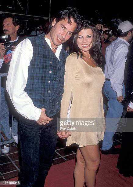 Actor Ricky Paull Goldin and actress Yasmine Bleeth attend the Planet Hollywood Grand Opening Celebration on March 25 1995 at Planet Hollywood Horton...