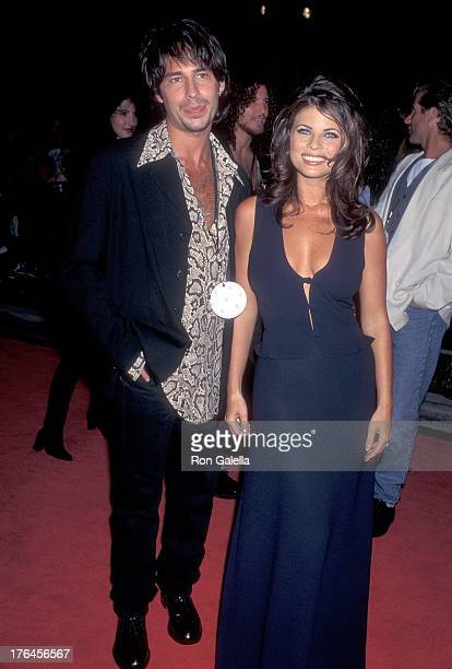 Actor Ricky Paull Goldin and actress Yasmine Bleeth attend the Planet Hollywood Grand Opening Celebration on September 17 1995 at Planet Hollywood...