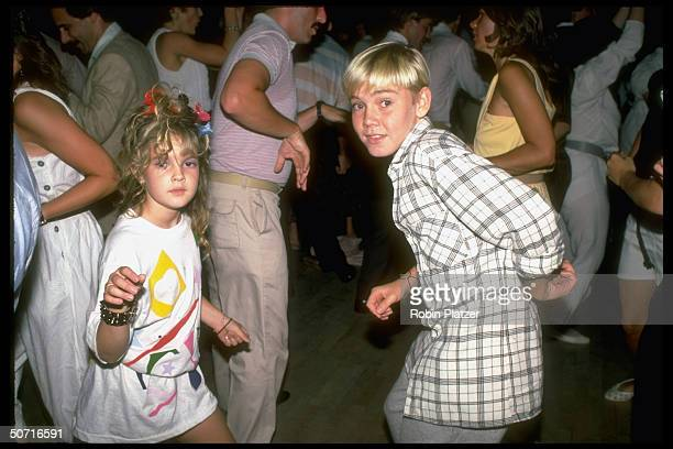 Actor Ricky Schroder and Drew Barrymore dancing