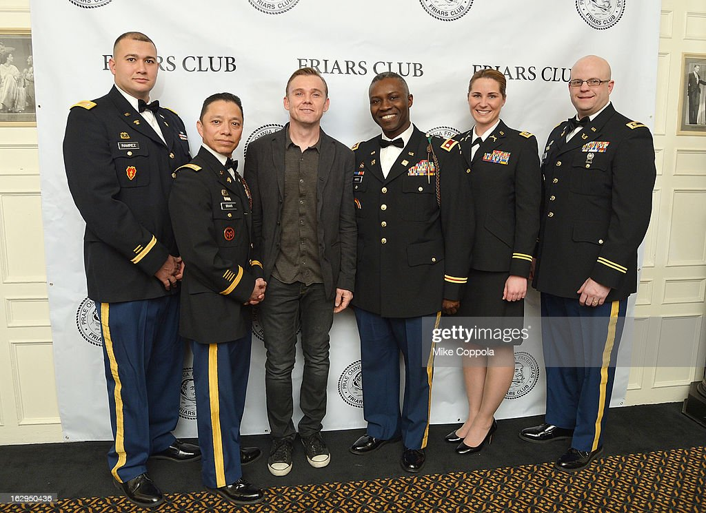 Actor Ricky Schroder poses for a picture with members of the United States Military at The Friars Club: 'So You Think You Can Roast?' Celebrating Ricky Schroder at New York Friars Club on March 1, 2013 in New York City.