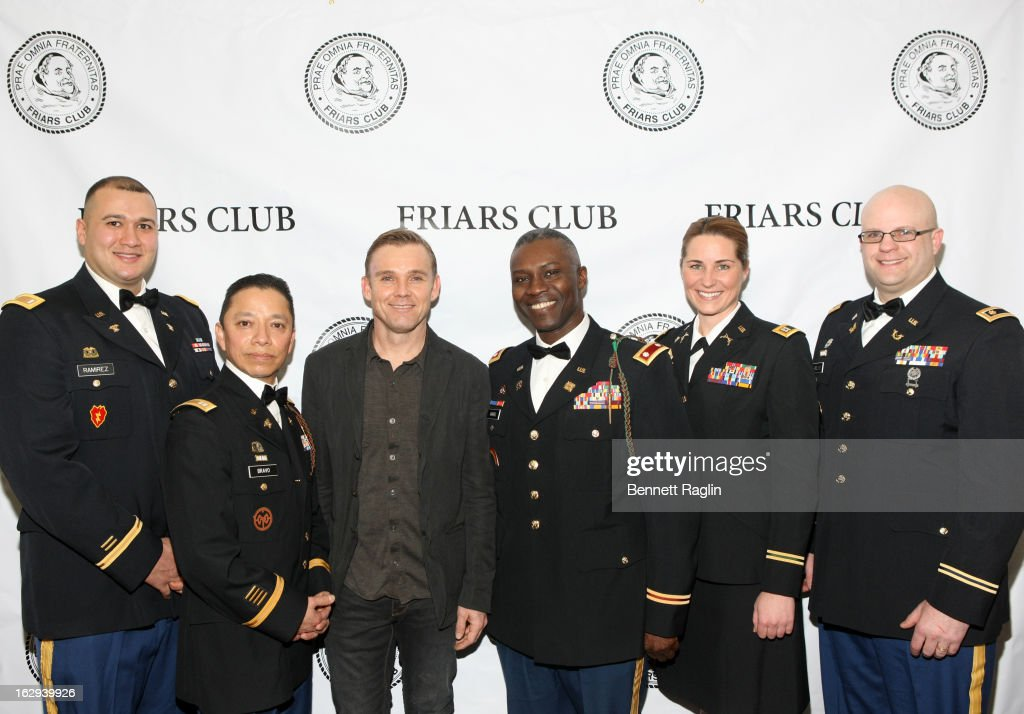 Actor Ricky Schroder(C) poses for a picture with members of the U.S. Army during the So You Think You Can Roast? at the New York Friars Club on March 1, 2013 in New York City.