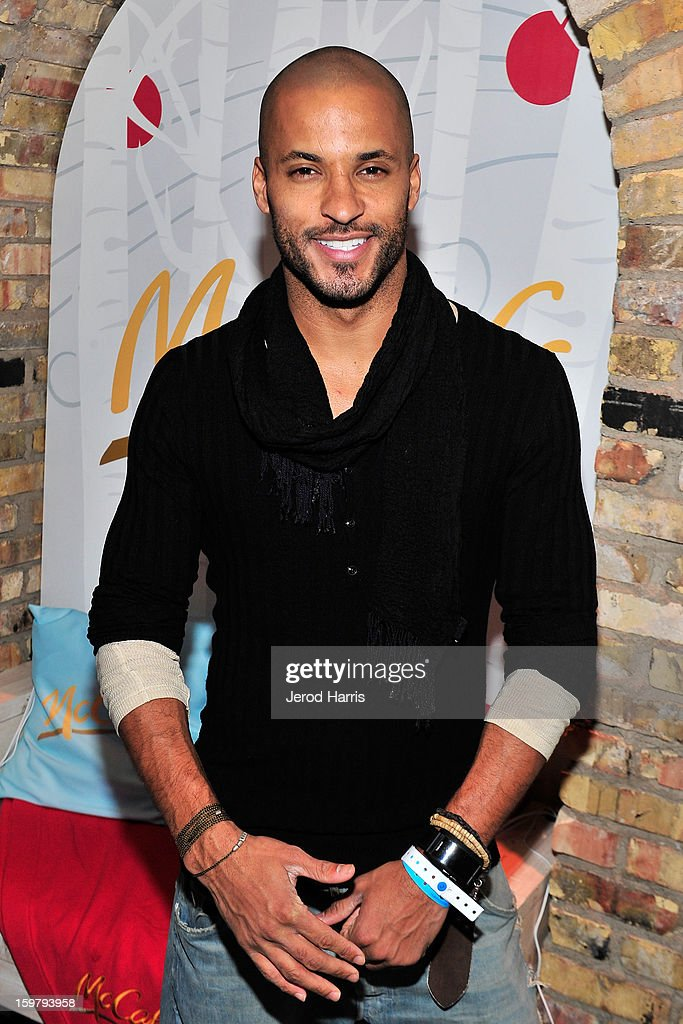 Actor <a gi-track='captionPersonalityLinkClicked' href=/galleries/search?phrase=Ricky+Whittle&family=editorial&specificpeople=3358286 ng-click='$event.stopPropagation()'>Ricky Whittle</a> warms up at the McDonald's McCafe Lodge at Sundance on January 20, 2013 in Park City, Utah.