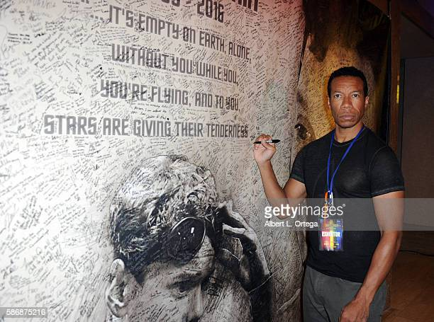 Actor Rico E Anderson signs the Anton Yelchin Rememberance banner on day 4 of Creation Entertainment's Official Star Trek 50th Anniversary Convention...