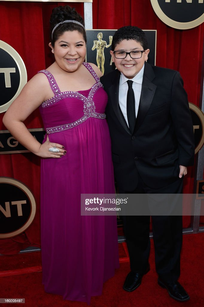 Actor Rico Rodriguez (R) and actor/singer Raini Rodriguez arrive at the 19th Annual Screen Actors Guild Awards held at The Shrine Auditorium on January 27, 2013 in Los Angeles, California.