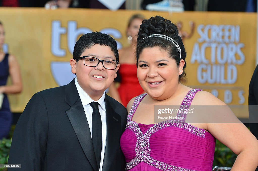 Actor Rico Rodriguez (L) and actor/singer Raini Rodriguez arrive at the 19th Annual Screen Actors Guild Awards held at The Shrine Auditorium on January 27, 2013 in Los Angeles, California.