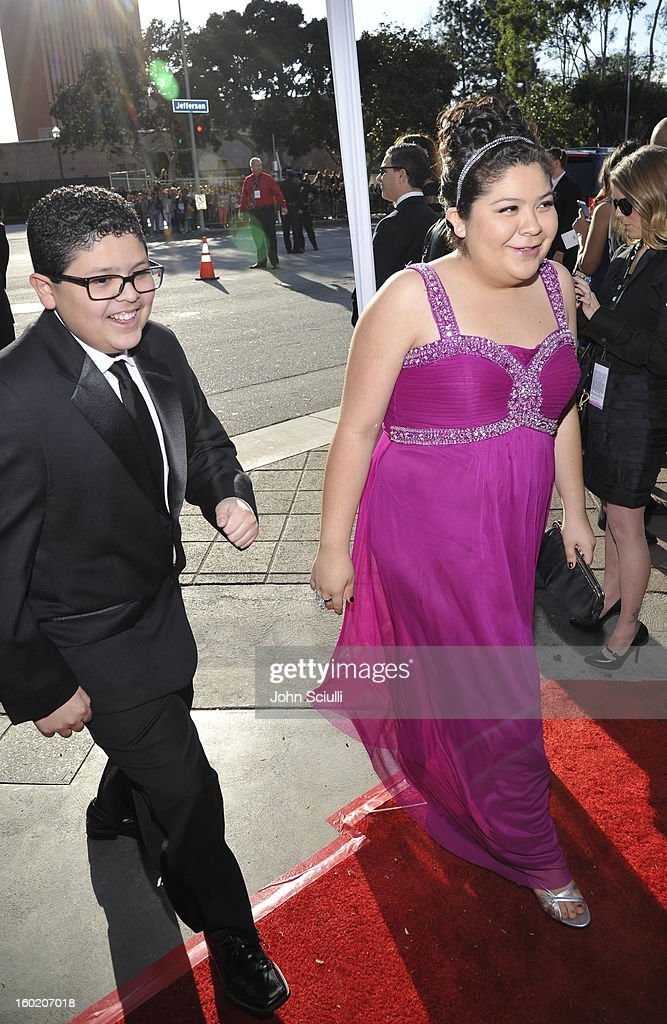 Actor Rico Rodriguez (L) and actor/singer Raini Rodriguez attend the 19th Annual Screen Actors Guild Awards at The Shrine Auditorium on January 27, 2013 in Los Angeles, California. (Photo by John Sciulli/WireImage) 23116_015_0297.jpg