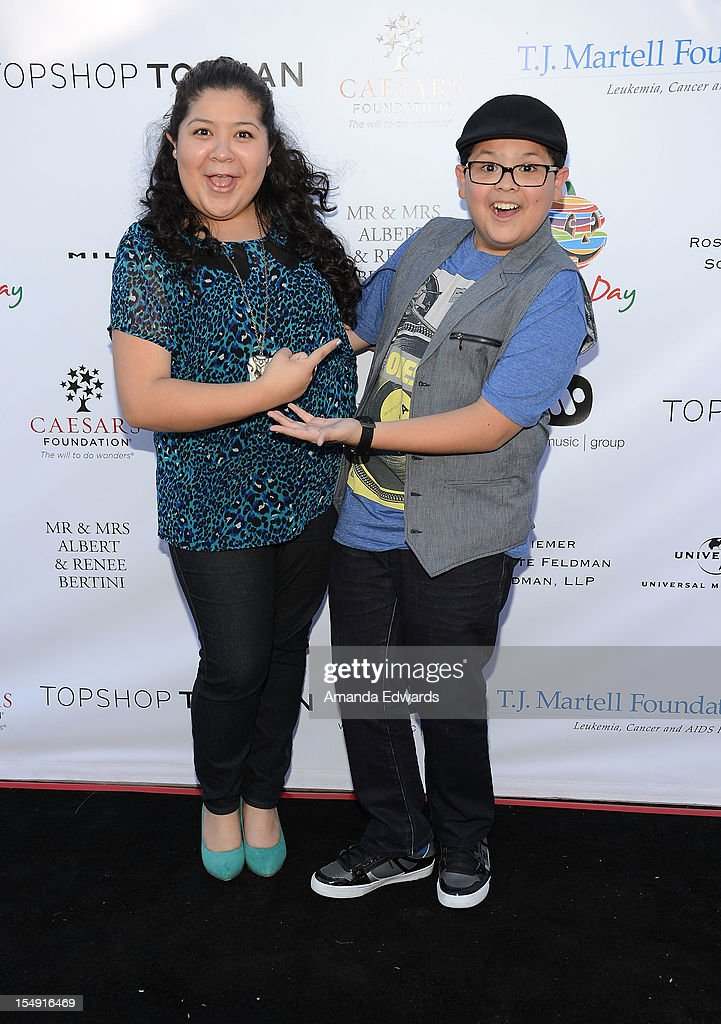 Actor Rico Rodriguez (R) and actress Raini Rodriguez arrive at the TJ Martell Foundation 4th Annual Family Day LA at CBS Studios - Radford on October 28, 2012 in Studio City, California.