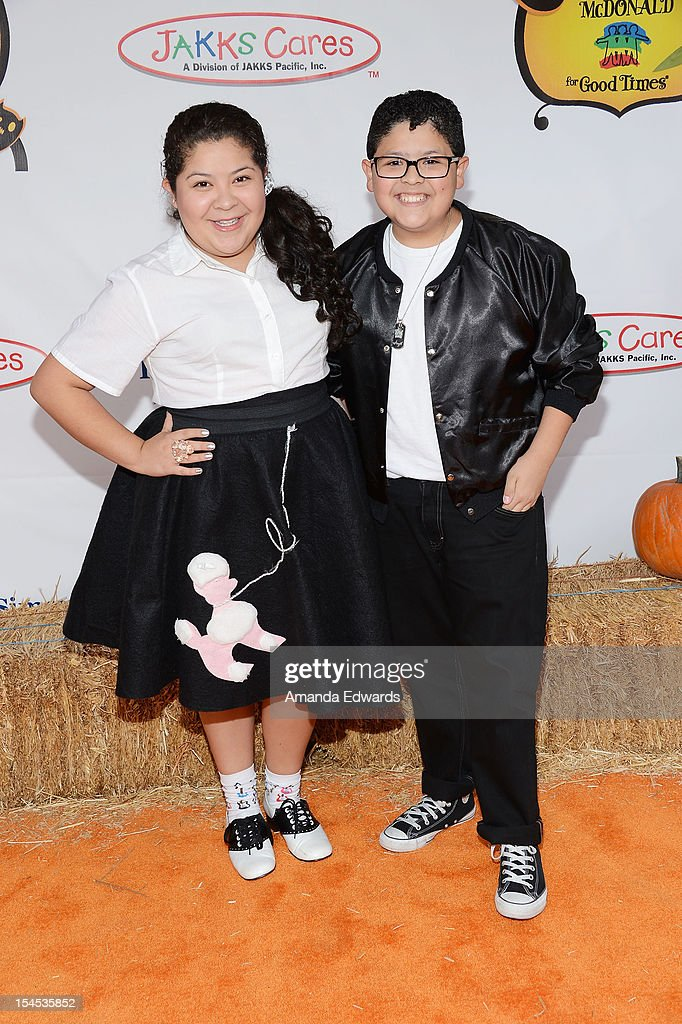Actor Rico Rodriguez (R) and his sister, actress Raini Rodriguez arrive at the Camp Ronald McDonald For Good Times 20th Annual Halloween Carnival at Universal Studios Backlot on October 21, 2012 in Universal City, California.