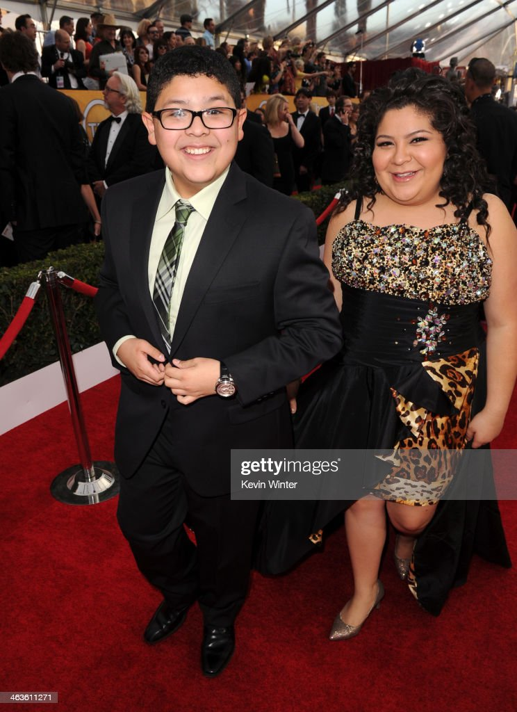 Actor Rico Rodriguez and Raini Rodriguez attend 20th Annual Screen Actors Guild Awards at The Shrine Auditorium on January 18 2014 in Los Angeles...