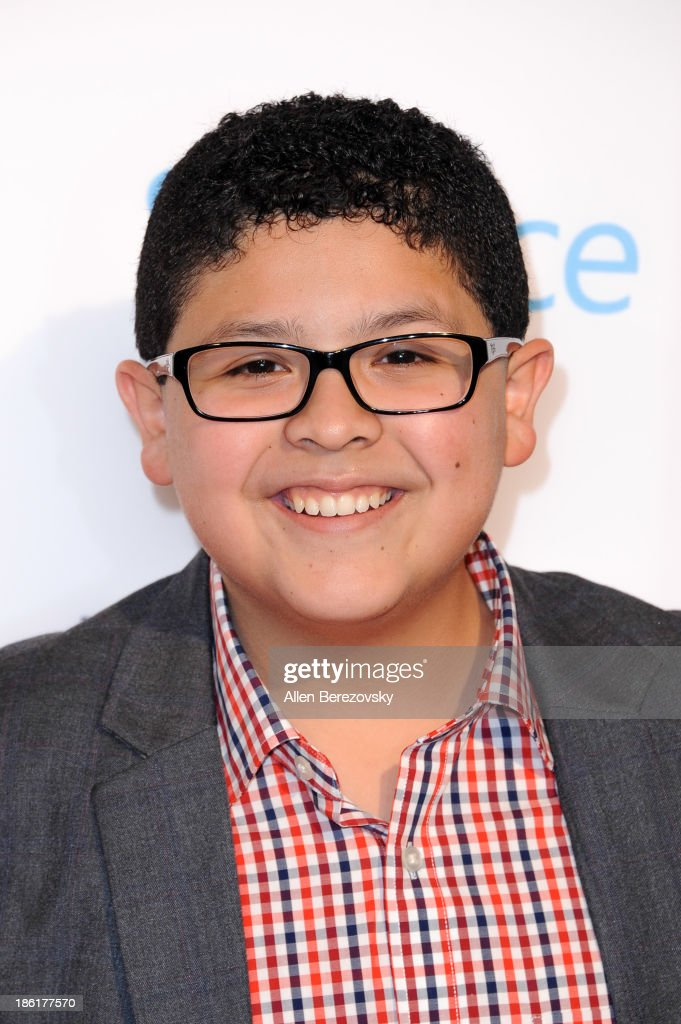 Actor Rico Rodriguez arrives at the 'Modern Family' Fan Appreciation Day hosted by USA Network at Westwood Village on October 28, 2013 in Los Angeles, California.