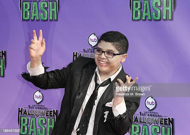 Actor Rico Rodriguez attends Hub Network's First Annual Halloween Bash in Barker Hangar at the Santa Monica Airport on October 20 2013 in Santa...