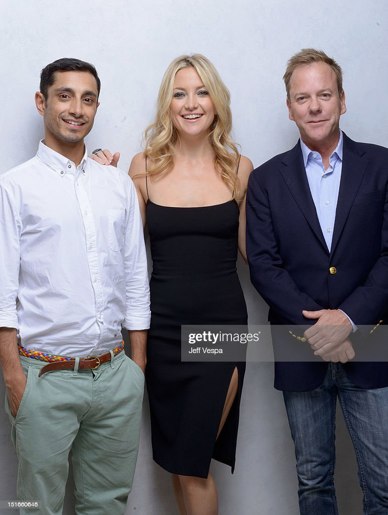Actor Riz Ahmed actress Kate Hudson and actor Kiefer Sutherland of 'The Reluctant Fundamentalist' pose at the Guess Portrait Studio during 2012...