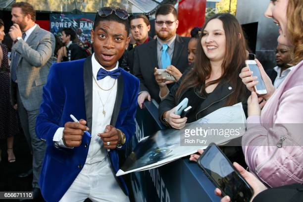 Actor RJ Cyler signs autographs at the premiere of Lionsgate's 'Power Rangers' at the Westwood Village Theatre on March 22 2017 in Westwood California