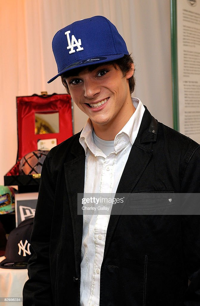 Actor RJ Mitte poses with the New Era Cap display during the HBO Luxury Lounge in honor of the 60th annual Primetime Emmy Awards featuring the In Style diamond suite, held at the Four Seasons Hotel on September 21, 2008 in Beverly Hills, California.