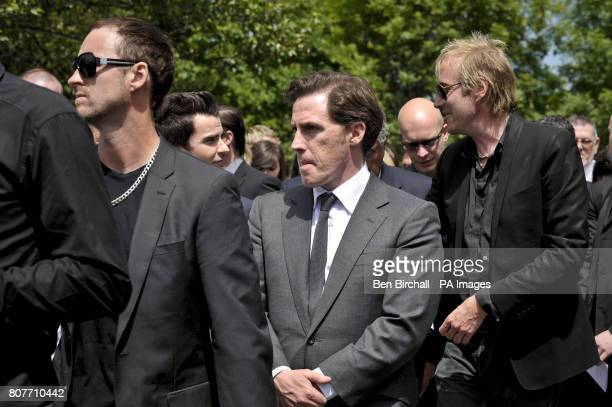 Actor Rob Brydon Actor Rhys Ifans Singer Kelly Jones and Dirty Sanchez star Lee Dainton leave the funeral service of exStereophonics drummer Stuart...