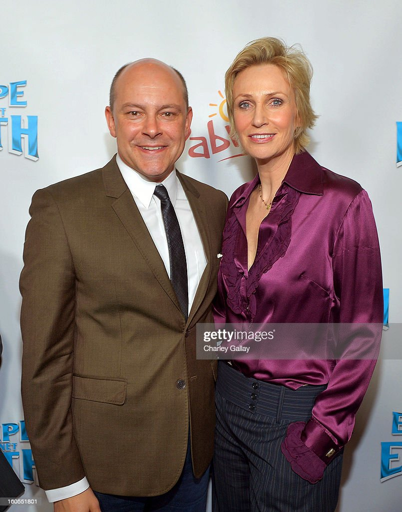 Actor Rob Corddry (L) and actress Jane Lynch attend the 'Escape From Planet Earth' premiere presented by The Weinstein Company in partnership with Sabra at Mann Chinese 6 on February 2, 2013 in Los Angeles, California.