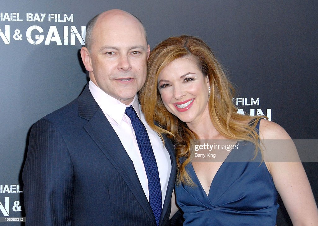 Actor Rob Corddry (L) and his wife Sandra Corddry arrive at the Los Angeles Premiere 'Pain & Gain' at TCL Chinese Theatre on April 22, 2013 in Hollywood, California.