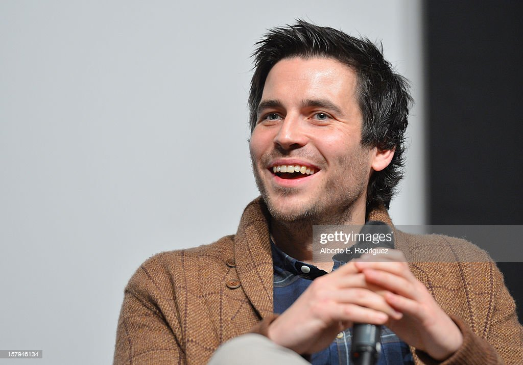Actor <a gi-track='captionPersonalityLinkClicked' href=/galleries/search?phrase=Rob+James-Collier&family=editorial&specificpeople=7201395 ng-click='$event.stopPropagation()'>Rob James-Collier</a> smiles onstage during the Q&A session as part of The Hollywood Reporter screening of PBS Masterpiece's 'Downton Abbey' Season 3 on December 7, 2012 in West Hollywood, California.