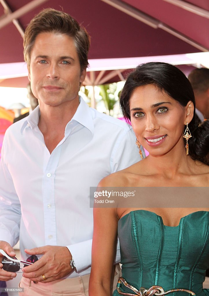 Actor Rob Lowe and actress Fagun Thakrar attend the Hollywood Reporter honors Jodi Foster for 'The Beaver' hosted by vitaminwater at Z Plage vitaminwater on May 18, 2011 in Cannes, France.