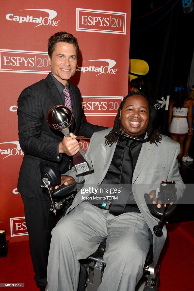 Actor <a gi-track='captionPersonalityLinkClicked' href=/galleries/search?phrase=Rob+Lowe&family=editorial&specificpeople=211607 ng-click='$event.stopPropagation()'>Rob Lowe</a> (L) poses with Eric LeGrand, winner of the Jimmy V Award for Perseverence pose backstage during the 2012 ESPY Awards at Nokia Theatre L.A. Live on July 11, 2012 in Los Angeles, California.