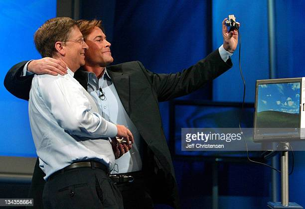 Actor Rob Lowe takes a self portrait of himself and Bill Gates chairman and chief software architect of Microsoft at the launch of the Tablet PC in...