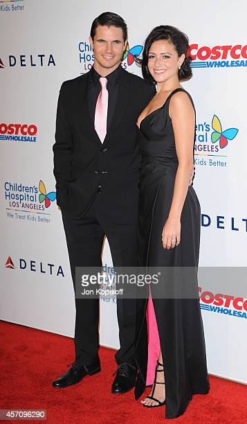 Actor Robbie Amell and actress Italia Ricci arrive at the Children's Hospital Los Angeles Gala Noche de Ninos at LA Live Event Deck on October 11...