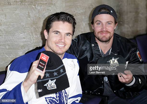 Actor Robbie Amell and his brother Steve Amell attend the 2017 Honda NHL AllStar Game at Staples Center on January 29 2017 in Los Angeles California