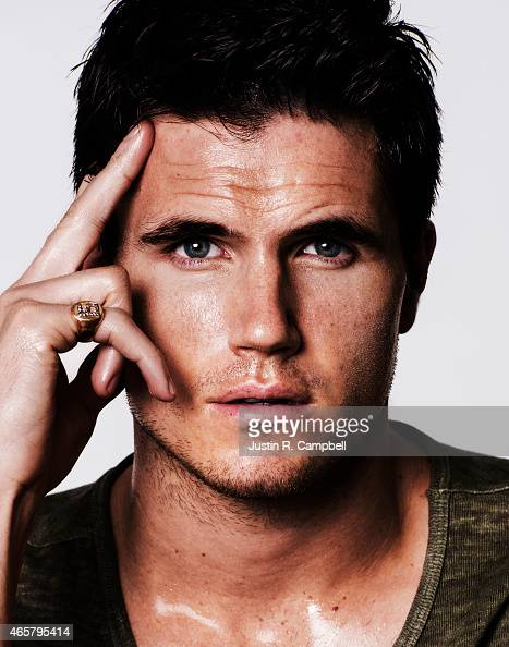 Actor Robbie Amell is photographed for Just Jared on February 21 2015 in Los Angeles California