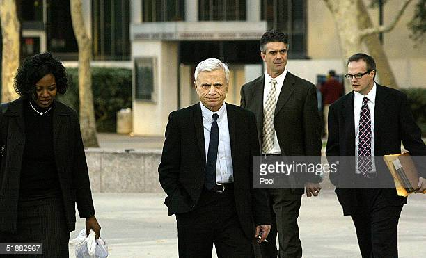 Actor Robert Blake leaves with some of his defense team after the first day of his trial in the alleged murder of his wife Bonny Lee Bakley at the...