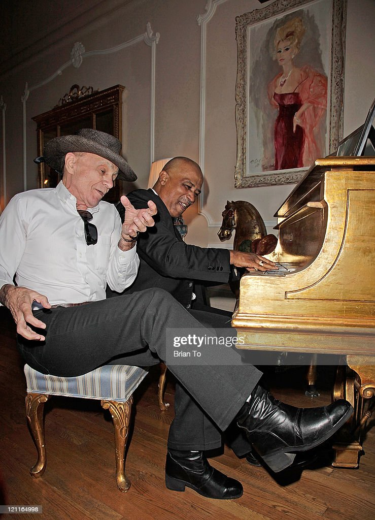 Actor Robert Blake sings with a pianist at Zsa Zsa Gabor and Prince Frederic 25th wedding anniversary party on August 14, 2011 in Los Angeles, California.