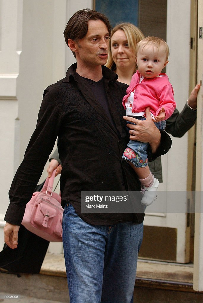 Actor Robert Carlyle with his wife Anastasia Shirley and daughter Ava go shoe shopping in the SoHo neighborhood May 15, 2003 in New York City.