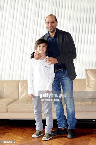 Actor Robert Dancs and Checco Zalone attend the 'Sole A Catinelle' photocall on October 30 2013 in Milan Italy