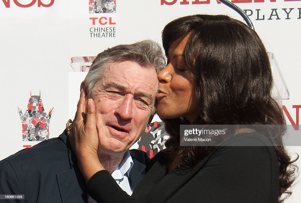 Actor <a gi-track='captionPersonalityLinkClicked' href=/galleries/search?phrase=Robert+De+Niro&family=editorial&specificpeople=201673 ng-click='$event.stopPropagation()'>Robert De Niro</a> and Grace Hightower attend <a gi-track='captionPersonalityLinkClicked' href=/galleries/search?phrase=Robert+De+Niro&family=editorial&specificpeople=201673 ng-click='$event.stopPropagation()'>Robert De Niro</a> Hand and Footprint Ceremony at TCL Chinese Theatre on February 4, 2013 in Hollywood, California.