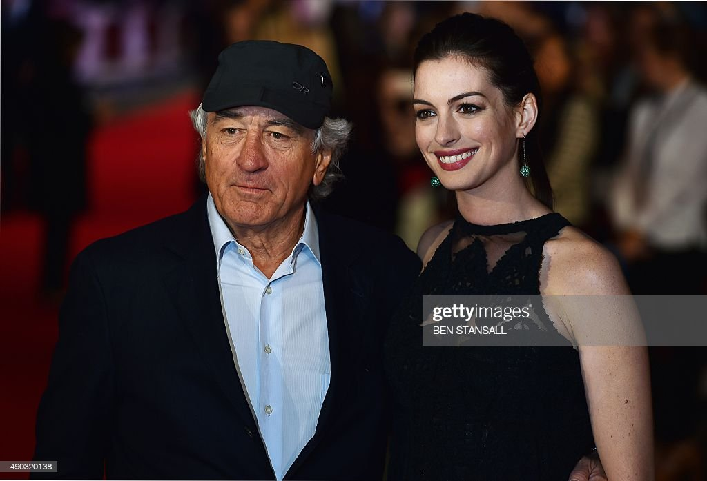 US actor Robert De Niro (L) and US actress <a gi-track='captionPersonalityLinkClicked' href=/galleries/search?phrase=Anne+Hathaway+-+Actriz&family=editorial&specificpeople=11647173 ng-click='$event.stopPropagation()'>Anne Hathaway</a> pose as they arrive for the European premiere of 'The Intern' on September 27, 2015 in London. AFP PHOTO / BEN STANSALL