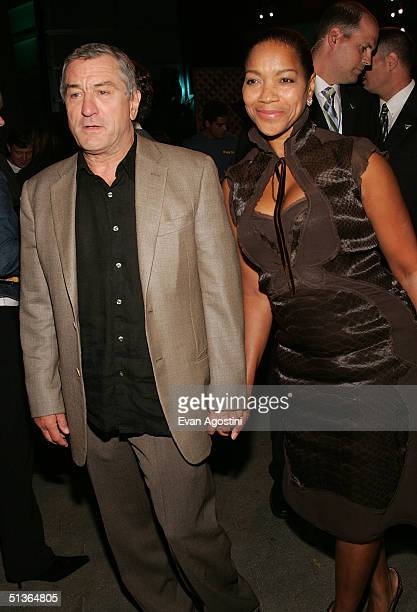 Actor Robert De Niro and wife Grace Hightower attend the 'Shark Tale' premiere at Central Park's Delacorte Theater on September 27 2004 in New York...
