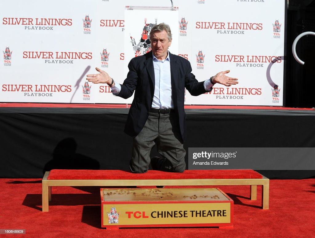Actor <a gi-track='captionPersonalityLinkClicked' href=/galleries/search?phrase=Robert+De+Niro&family=editorial&specificpeople=201673 ng-click='$event.stopPropagation()'>Robert De Niro</a> attends his hand and foot print ceremony at TCL Chinese Theatre on February 4, 2013 in Hollywood, California.