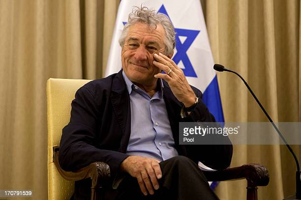 Actor Robert De Niro gestures prior to his meeting with Israel's President Shimon Peres at the President's residence in Jerusalem on June 18 2013 in...