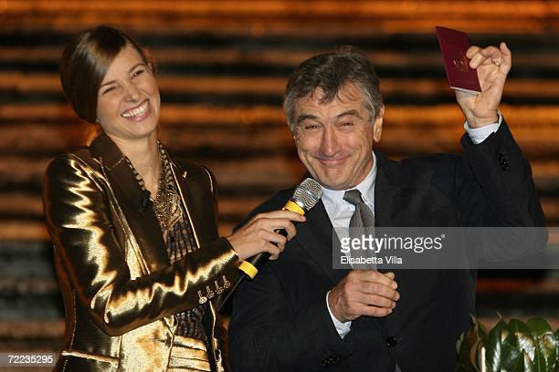 Actor Robert De Niro gestures with his new Italian passport during the Steps And Stars Award in Piazza di Spagna as part of the Rome Film Festival on...