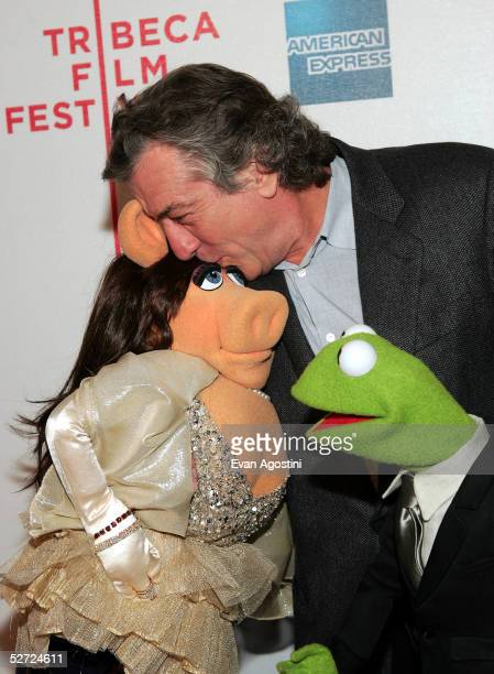 Actor Robert De Niro kisses Miss Piggy as Kermit The Frog looks on during the premiere of 'The Muppets Wizard of Oz' at the Tribeca FAMILY Festival...
