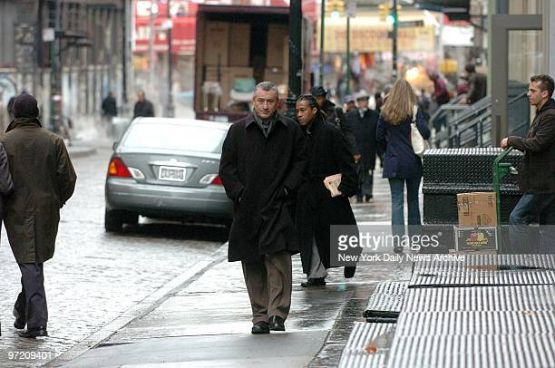 Actor Robert De Niro plays a street scene while filming a commercial for the third annual Tribeca Film Festival and the area's arts scene