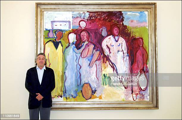 US actor Robert De Niro poses next to a painting by his father Robert Sr on display at La Pisine in an exhibition of Robert De Niro Sr paintings on...