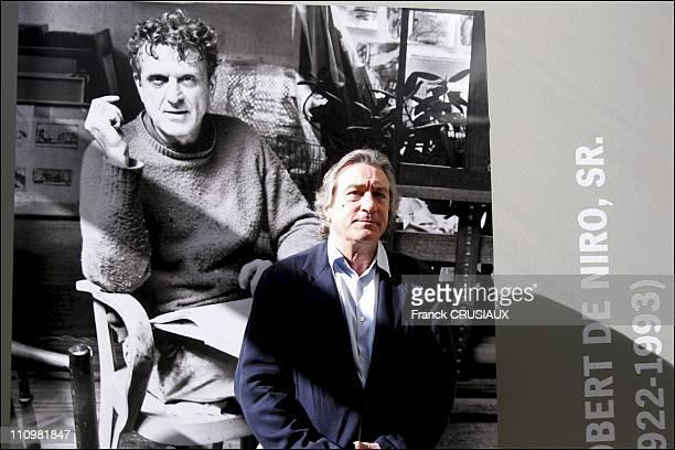 US actor Robert De Niro poses next to a portrait of his father Robert Sr in an exhibition of Robert De Niro Sr paintings at La Piscine in Roubaix...