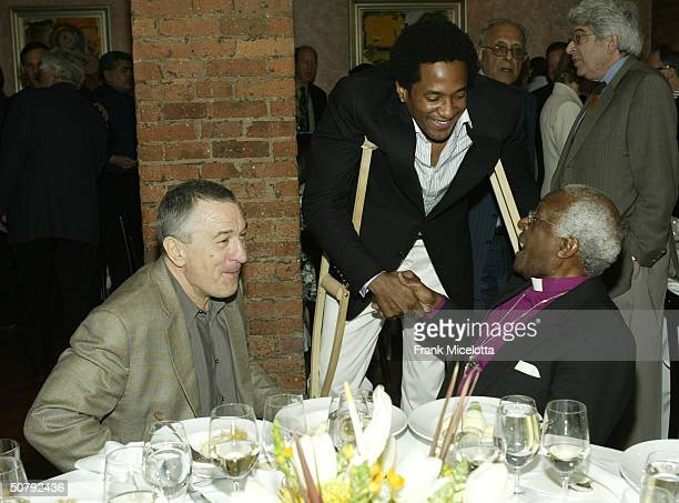 Actor Robert De Niro rapper/actor QTip and Archbishop Desmond Tutu attend the VIP Opening Luncheon at the Tribeca Loft May 1 2004 in New York City