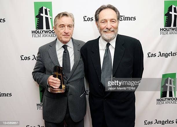 Actor Robert De Niro winner of the Hollywood Supporting Actor Award poses with screenwriter Eric Roth during the 16th Annual Hollywood Film Awards...
