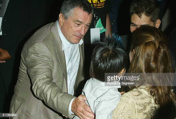 Actor Robert De Niro with actress Angelina Jolie and her son Maddox at the World Premiere of 'Shark Tale' in San Marco Square as part of the 61st...