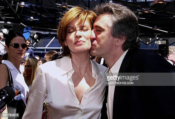 US actor Robert DeNiro kisses costar Rene Russo as they meet at the premiere of their new film 'The Adventures of Rocky and Bullwinkle' at Universal...